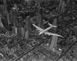 DC-4 flying over New York City, by Margaret Bourke-White, 1939