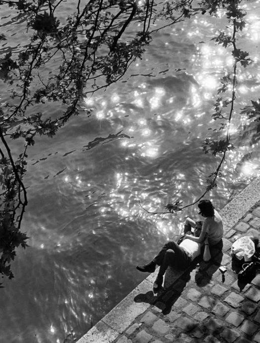 Couple Relaxing on Bank of the Seine River, by Alfred Eisenstaedt, 1963